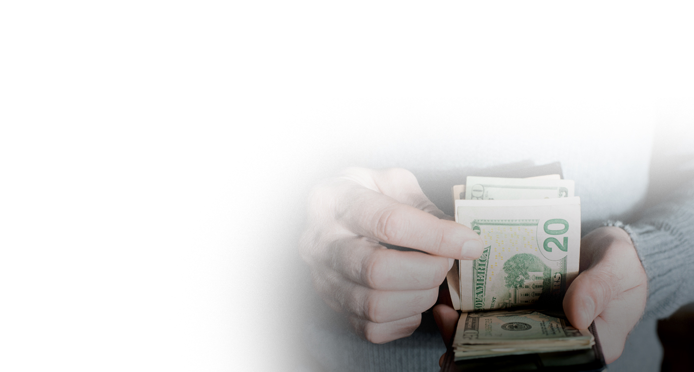 Banner image with a set of hands counting money
